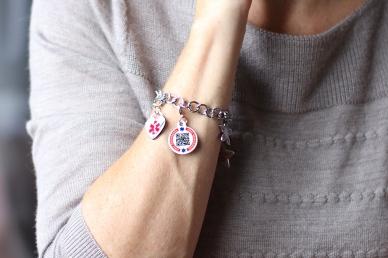 ECI Charm Bracelet on adult wrist http://dynotag.hostedbywebstore.com/Dynotag®-Enabled-Emergency-Information-Bracelet/dp/B00P3BMY1Y