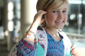 ECI Charm Bracelet on small wrist http://dynotag.hostedbywebstore.com/Dynotag®-Enabled-Emergency-Information-Bracelet/dp/B00P3BMY1Y